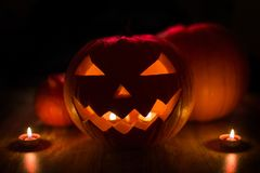 Halloween jack-o-lantern burning in darkness. Halloween and holidays concept - spooky jack-o-lantern or carved pumpkin lantern burning in darkness Royalty Free Stock Photo