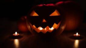 Halloween jack-o-lantern burning in darkness stock video footage