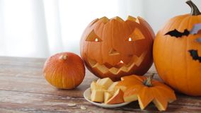 Jack-o-lantern or carved halloween pumpkins stock video