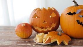 Jack-o-lantern or carved halloween pumpkins stock video