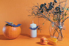 Halloween home decorations on orange background Royalty Free Stock Images
