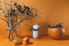 Halloween home decorations on orange background Stock Image