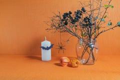 Halloween home decorations on orange background Royalty Free Stock Image