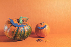 Halloween home decorations on orange background Royalty Free Stock Photography