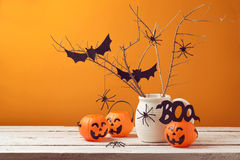 Halloween home decorations with spiders and pumpkin bucket. For trick or treat Royalty Free Stock Photos