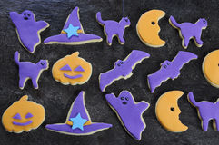 Halloween homemade cookies on black slate kitchen bench top. Stock Image