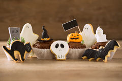 Halloween homemade gingerbread cookies and cupcakes. Background Royalty Free Stock Image