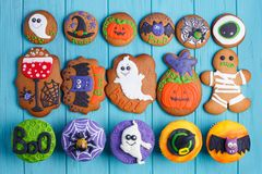 Halloween homemade gingerbread cookies and cupcakes background. royalty free stock photos