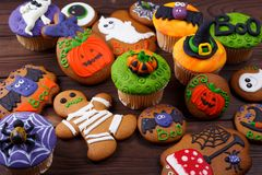 Halloween homemade gingerbread cookies and cupcakes background. royalty free stock photography