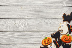 Halloween homemade gingerbread cookies. Over wooden background Royalty Free Stock Photo
