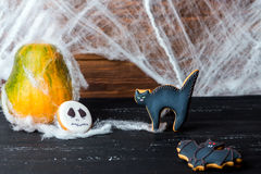 Halloween homemade gingerbread cookies over wooden table Stock Photography