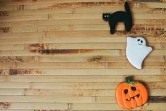 Halloween homemade gingerbread cookies on wood table Stock Photos