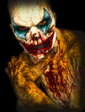 Halloween horror clown. With painted face and blood portrait Royalty Free Stock Images