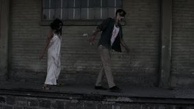 Halloween horror concept. Picture of creepy male and female ghost or zombie walking with wounded face. An old abandoned