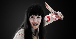 Crazy bloody scary zombie girl with butcher cleaver stock image