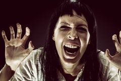Halloween scary brunette woman with long hair royalty free stock photography
