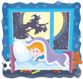 Halloween horror night. The All Hallows Eve night, a little boy in fear hiding under the blanket in his bed, a witch flying on her broom outside the window Stock Image