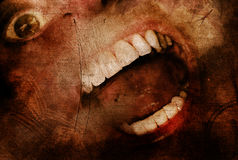 Halloween horror. A screaming wide open mouth with teeth bared on a textured background.  Concept for Halloween horror or a scary event Royalty Free Stock Image