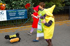Halloween Hot Dog. Ketchup, relish, mustard, and hot dog, march in the annual Halloween dog costume parade in Brooklyn Heights, New York stock image