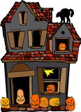 Halloween House. Colorful illustration of a haunted house with carved pumpkins and a black cat.  Isolated against a white background Royalty Free Stock Photography