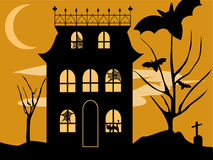 Halloween House. Vector Halloween haunted house with spooky spiderwebs, black cat, bats and graveyard on a moody night Stock Images