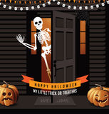Halloween house with jack o lanterns and waving skeleton Stock Photo