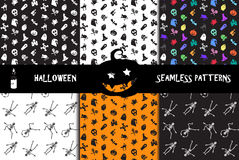 Halloween icons seamless patterns set Royalty Free Stock Images
