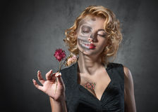 Halloween image – female portrait with dried flowers