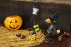 Halloween image with crow and Jack o lantern Stock Photo