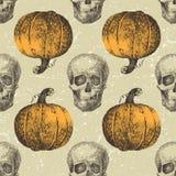 Halloween inconsútil con los sculls y las calabazas libre illustration