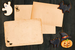 Halloween invitation over wooden background Royalty Free Stock Images