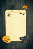 Halloween invitation over wooden background Royalty Free Stock Photos
