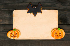 Halloween invitation over wooden background Royalty Free Stock Image