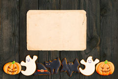Halloween invitation over wooden background Stock Photo