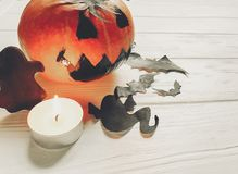 Halloween. jack lantern pumpkin with witch ghost bats and spider. Black decorations on white wooden background. simple cutouts for autumn holiday celebration Stock Image