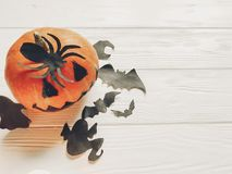 Halloween. jack lantern pumpkin with witch ghost bats and spider. Black decorations on white wooden background. simple cutouts for autumn holiday celebration Stock Photos