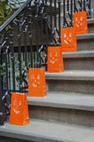 Halloween. Jack lantern pumplin faced bags line the stairs on Halloween to guide the trick or treaters Royalty Free Stock Photo