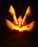 Halloween Jack O' Lantern. Jack O 'Lantern with interior light with stretched out eyes and mouth Royalty Free Stock Photo