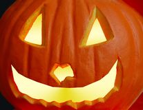 Halloween Jack O Lantern. A carved and lit jack o lantern pumpkin with space for copy Stock Photography