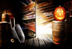 Halloween jack-o-lantern in barn Stock Image