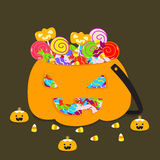 Halloween Jack o lantern bucket full of candies vector illustration. Halloween Jack o lantern bucket full of candies and lollipops and tiny pumpkin candles Royalty Free Stock Image