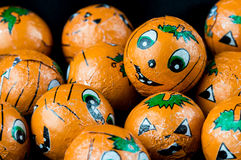 Halloween Jack-o-lantern candy balls close up. Close up of Halloween Jack-o-lantern foil covered sweets. Ready to hand out to Trick or Treaters Stock Image