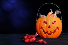 Halloween Jack o Lantern candy collector full of candy and some royalty free stock images