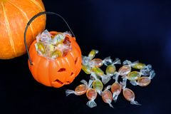 Halloween Jack o Lantern candy collector full of candy and some stock image
