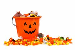 Halloween Jack o Lantern candy collector with candy over white Stock Photo
