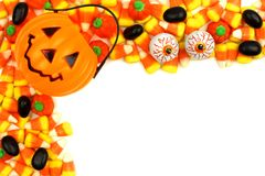 Halloween Jack o Lantern candy holder with candy corner border Stock Photography