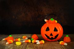 Halloween Jack-o-Lantern candy holder with orange and black background Royalty Free Stock Image
