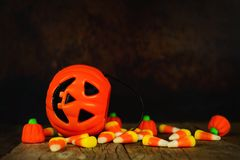 Halloween Jack-o-Lantern candy holder with orange and black background Stock Images