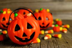 Halloween Jack o Lantern candy holders close up on wood Stock Photography