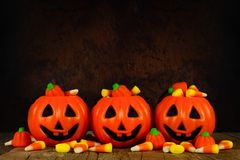 Halloween Jack-o-Lantern candy holders with orange and black background Royalty Free Stock Photography